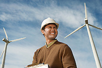 Engineer near wind turbines at wind farm