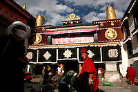 Devout Buddhists pray in front of the Jokhang Temple in Lhasa, the capital of Tibet in western China. (Photo/Scott Dalton)