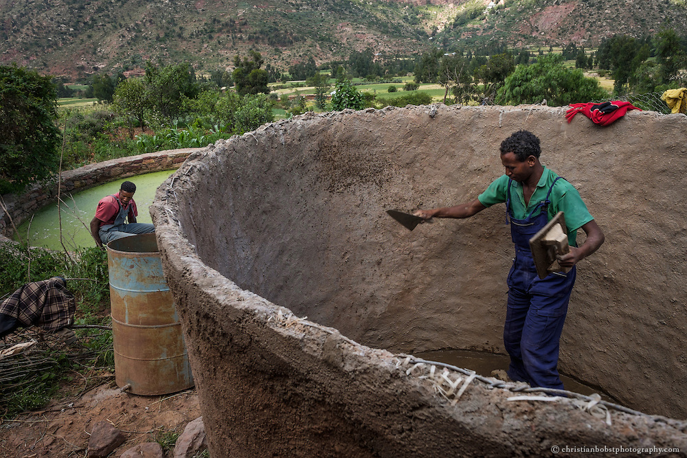 Beles Sunrise project BSP, water harvesting & irrigation. Village technician Halle Selassie Hagos from Beleso constructs a water harvesting cistern at the home of Araya Hadish (63).