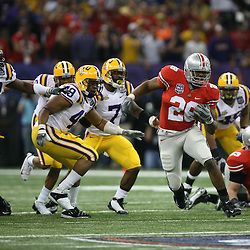 "07 January 2008: Ohio State running back Chris ""Beanie"" Wells runs through a hole in the LSU defense during the 2008 All State BCS Championship game a 38-24 win by the LSU Tigers over the Ohio State Buckeyes at the Louisiana Superdome in New Orleans, Louisiana."