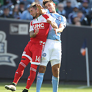 Diego Fagundez, New England, is fouled by Andoni Iraola, NYCFC, during the New York City FC Vs New England Revolution, MSL regular season football match at Yankee Stadium, The Bronx, New York,  USA. 26th March 2016. Photo Tim Clayton