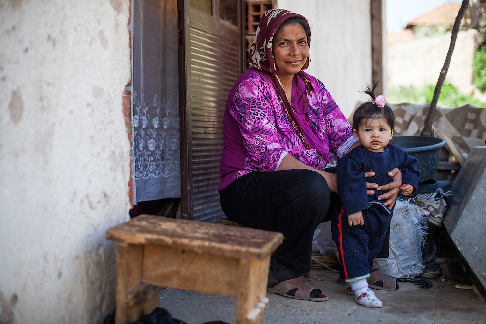 Inhabitants in the Roma part: A woman with child in the city of Crnik, Macedonia.