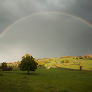 A full rainbow in the rain, St. Flour L´Etang, France