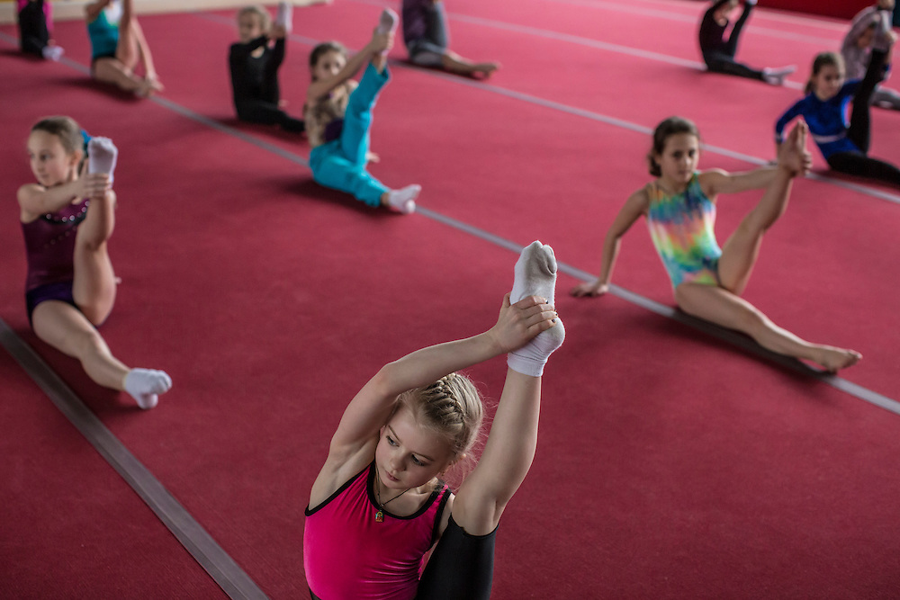 DONETSK, UKRAINE - FEBRUARY 2, 2015: Young gymnasts train at Dynamo, the same gym in which Lilia Podkopayeva trained in Donetsk, Ukraine. In the 1996 Olympics, Podkopayeva won the gold medal in women's gymnastics all-around as well as gold and silver individual event medals CREDIT: Brendan Hoffman for The New York Times