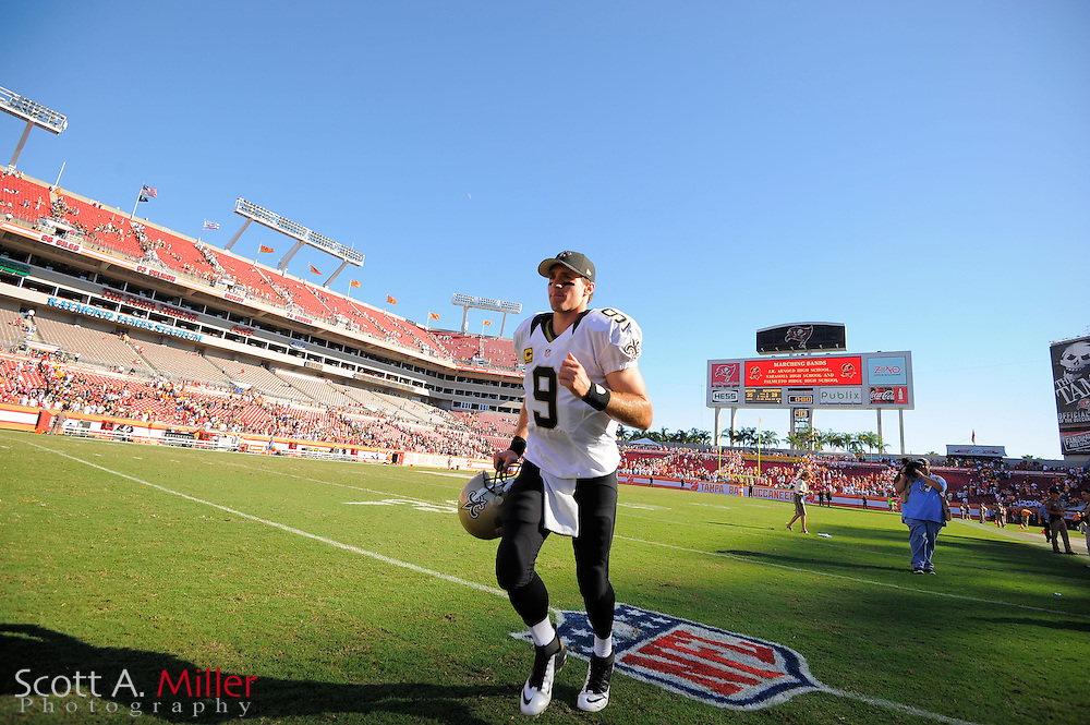 New Orleans Saints quarterback Drew Brees (9)leaves the field after his team's win over the Tampa Bay Buccaneers at Raymond James Stadium  on Oct. 14, 2012 in Tampa, Florida. The Saints won 35-28....©2012 Scott A. Miller...