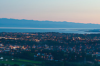 The view of Victoria, BC from Mt. Doug on a summer's evening features sparkling downtown lights, ocean view and the distant Olympic Mountains.
