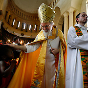Anglican Archbishop Rowan Williams of Canterbury blesses a young girl as he leaves Anglican cathedral in Zanzibar following Sunday services. Leaders of the world's 77 million Anglicans, in Tanzania for a closed, six-day conference, traveled by boat from the mainland for a Solemn Eucharist in the only Anglican cathedral on this predominantly Muslim archipelago on the Indian Ocean. .