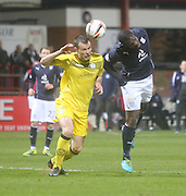 Christian Nade challenges for a header - Dundee  v Queen of the South - SPFL Championship at Dens Park<br /> <br />  - &copy; David Young - www.davidyoungphoto.co.uk - email: davidyoungphoto@gmail.com