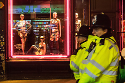 London, January 01 2018. Police patrol on Wardour Street, Soho, as revellers in London's West End enjoy New Year's Eve. © SWNS