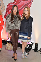 Left to right, ROXIE NAFOUSI and ROSIE FORTESCUE at the launch of The Lulu Perspective to celebrate 25 years of Lulu Guinness held at 74a Newman Street, London on 13th September 2014.