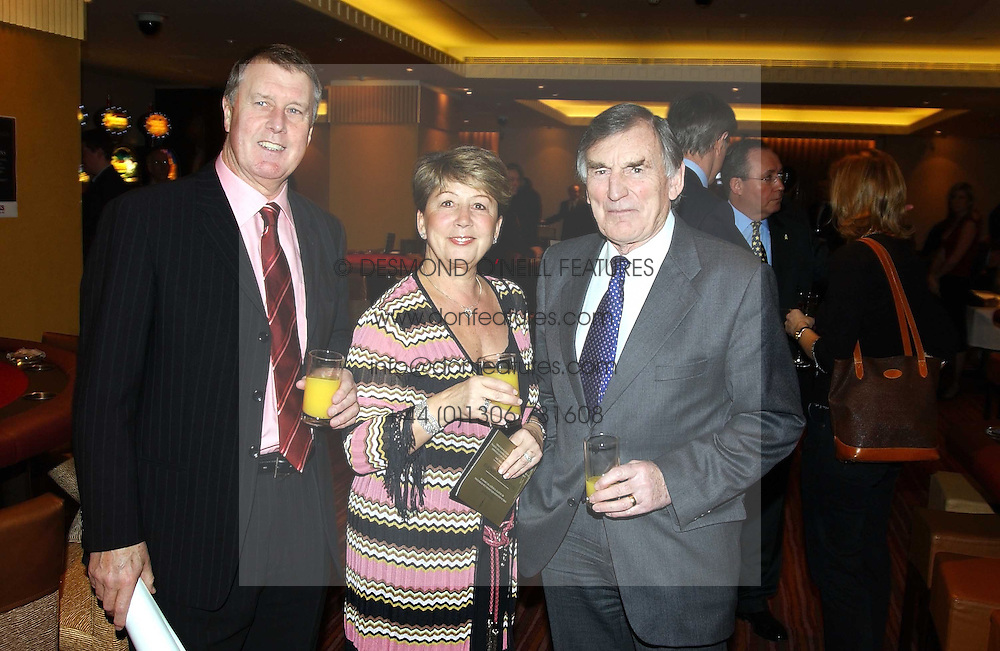 Left to right, SIR GEOFF & LADY HURST and footballer DEREK UFTON a director of Charlton Athletic FC at a party to celebrate the opening of The Sportsman - a casino, bar and restaurant in Old Quebec Street, London W1 on 12th January 2005.  Proceeds from the casino were donated to the charity Sparks the sports charity.<br />