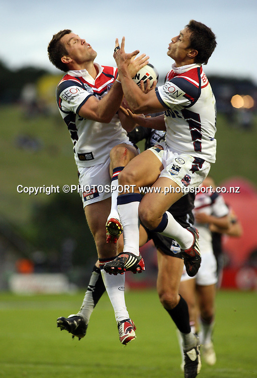 Roosters wing Sam Perrett jumps for the ball.<br />