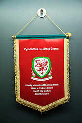 CARDIFF, WALES - Thursday, March 24, 2016: Wales match pennant in the dressing room before the International Friendly match against Northern Ireland at the Cardiff City Stadium. (Pic by David Rawcliffe/Propaganda)