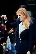 Sarah Ferguson, the Duchess of York, waves to students as she departs Weyanoke Elementary school October 20, 1995 in Alexandria, Virginia. The duchess watched the students take an eye exam and will later attend the International Eye Foundations Eye Ball to raise funds for improving eye care for children.