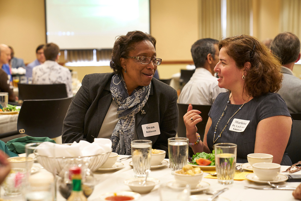 Dwan Robinson and Marlene De La Cruz-Guzman talk at the 2017 Multicultural Welcome Luncheon.