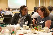 Dwan Robinson and Marlene De La Cruz-Guzman talk at the 2017 Multicultural Welcome Luncheon.