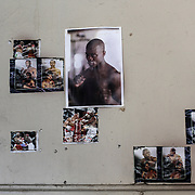 On the walls of the Hillbrow Boxing Club, pictures of the champions produced by the club are hanged alongside posters of international boxing stars.