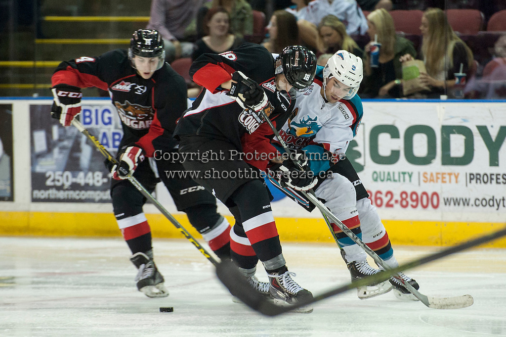 KELOWNA, CANADA - SEPTEMBER 5: Bartek Bison #18 of Prince George Cougars checks Tanner Wishnowski #9 of Kelowna Rockets on September 5, 2015 during the first pre-season game at Prospera Place in Kelowna, British Columbia, Canada.  (Photo by Marissa Baecker/Shoot the Breeze)  *** Local Caption *** Tanner Wishnowski; Bartek Bison;