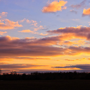 """""""In the Warmth of the Winter""""<br /> <br /> Beautiful cotton candy colored clouds bring a hint of warmth to a lovely winter sunset over a rural farm field!!<br /> <br /> Sunset Images by Rachel Cohen"""