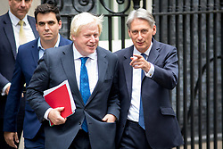 © Licensed to London News Pictures. 21/09/2017. London, UK. Foreign and Commonwealth Secretary Boris Johnson and Chancellor of the Exchequer Philip Hammond leaving No 10 Downing Street after attending a Cabinet meeting this morning. Photo credit : Tom Nicholson/LNP