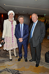 Left to right, LADY EMMA KITCHENER-FELLOWES, IRVINE SELLAR developer of The Shard and LORD FELLOWES OF WEST STAFFORD at a party to celebrate Jack Petchey's 90th birthday in association with the Stroke Association held at the Shangri-La Hotel, Level 34, The Shard, London on 13th July 2015.