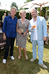 Left to right, DON FELDER, The COUNTESS OF MARCH and SIR JONATHAN IVE at the Cartier 'Style et Luxe' part of the Goodwood Festival of Speed, Goodwood House, West Sussex on 14th July 2013.