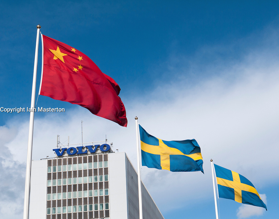 Chinese and Swedish flags flying outside Volvo factory in Gothenburg Sweden