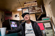 Navy veteran George McAllister of nearby Rankin hangs out in Al's Market in Braddock.<br />