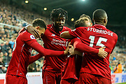 Divock Origi (#27) of Liverpool celebrates Liverpool's third goal (2-3) with Liverpool team mates during the Premier League match between Newcastle United and Liverpool at St. James's Park, Newcastle, England on 4 May 2019.