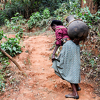 Women carry heavy clay pots to fetch water when water flows in the streams.