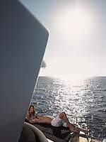 Couple Sunbathing on Boat