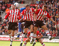 Fotball<br /> Premier League England<br /> 24.10.2004<br /> Foto: SBI/Digitalsport<br /> NORWAY ONLY<br /> <br /> Southampton v Birmingham City<br /> <br /> Southampton's Rory Delap, Jelle Van Damme and Andreas Jakobson keep out anouther Birming attack