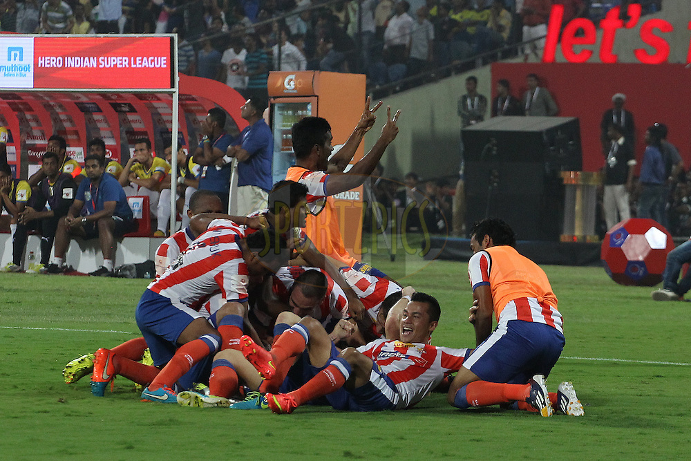 Kolkata celebrate the winning goal  during the final of the Hero Indian Super League between Kerala Blasters FC and Atletico de Kolkata held at the D.Y. Patil Stadium, Navi Mumbai, India on the 20th December 2014.<br /> <br /> Photo by:  Ron Gaunt / ISL/ SPORTZPICS