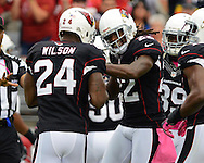Oct. 14, 2012; Glendale, AZ, USA;  Arizona Cardinals cornerback William Gay (22) celebrates with strong safety Adrian Wilson (24) after intercepting the ball against the Buffalo Bills in the first half at University of Phoenix Stadium. Mandatory Credit: Jennifer Stewart-US PRESSWIRE..
