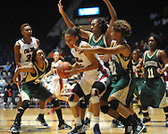Ole Miss' Kenyotta Jenkins dribbles against Southeastern Louisiana's Nanna Pool, back, and Aja Gibson (2) in Oxford, Miss. on Friday, November 9, 2012. (AP Photo/Oxford Eagle, Bruce Newman)