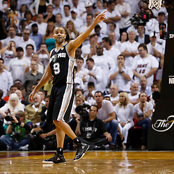 Jun 18, 2013; Miami, FL, USA; San Antonio Spurs point guard Tony Parker (9) reacts during the third quarter of game six in the 2013 NBA Finals against the Miami Heat at American Airlines Arena.  Mandatory Credit: Derick E. Hingle-USA TODAY Sports