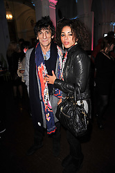 RONNIE WOOD and ANA ARAUJO at an exhibition and charity auction entitled Shoebox Art in aid of Kids Company held at the Haunch of Venison, Burlington Gardens, London on 18th March 2010.