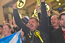 SCOTTISH PARLIAMENTARY ELECTION 2016 &ndash; Scottish National Party (SNP) supporters celebrate winning the Peatlands area vote at the Scottish Parliament Elections, at the Royal Highland Centre, Edinburgh for the counting of votes and declaration of results.<br /> (c) Brian Anderson | Edinburgh Elite media
