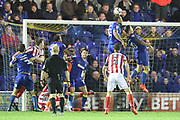 AFC Wimbledon defender Darius Charles (32) clearing the ball during the The FA Cup match between AFC Wimbledon and Lincoln City at the Cherry Red Records Stadium, Kingston, England on 4 November 2017. Photo by Matthew Redman.