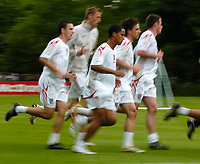 Photo: Richard Lane.<br />England Training Session. 22/05/2006.<br />England's players on a warm up during training, with Theo Walcott (C).