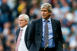 Manager Manuel Pellegrini of Manchester City looks on as Stoke Manager Mark Hughes stands behind  - Photo mandatory by-line: Rogan Thomson/JMP - 07966 386802 - 30/08/2014 - SPORT - FOOTBALL - Manchester, England - Etihad Stadium - Manchester City v Stoke City - Barclays Premier League.
