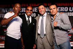 May 19, 2009; New York, NY, USA; Floyd Mayweather Jr. (l) and Juan Manuel Marquez (r) pose with Leonard Ellerbe and Oscar De La Hoya at the press conference announcing their upcoming fight.  The two will meet on July 18, 2009 at the MGM Grand Garden Arena in Las Vegas, NV.