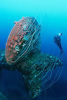 Bikini Atoll Marshall Islands Pacific Ocean scuba diver swimming near propeller of sunken battleship HIJMS Nagato