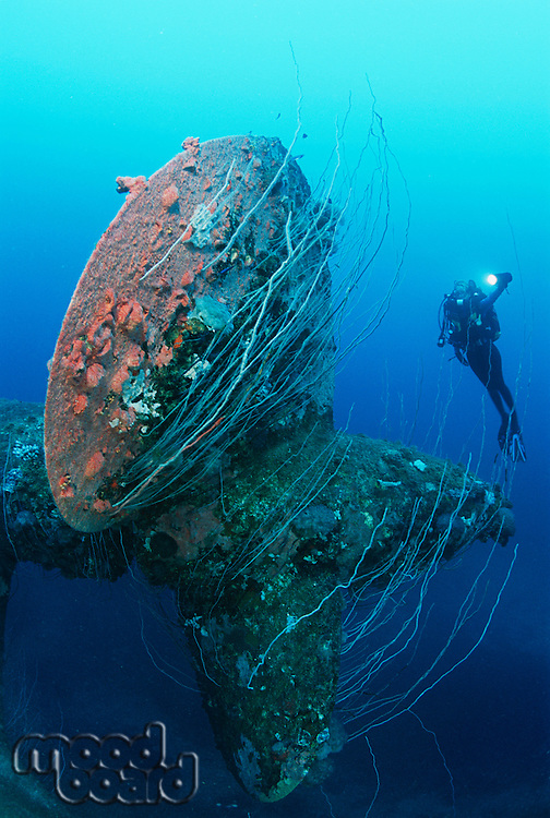 Bikini Atoll Marshall Islands Pacific Ocean scuba diver swimming near propeller of sunken battleship HIJMS Nagato