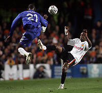 Photo: Paul Thomas.<br /> Chelsea v Valencia. UEFA Champions League. Quarter Final, 1st Leg. 04/04/2007.<br /> <br /> Soloman Kalou of Chelsea jumps in front of Luis Miguel (R).