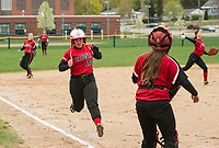 Taylor Morrill runs home off a base hit from Alyson Von George during NHIAA Division III softball at Opechee Park on Tuesday afternoon.  (Karen Bobotas/for the Laconia Daily Sun)