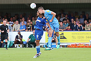 AFC Wimbledon striker Kweshi Appiah (9) battles for possession with Coventry City defender Dominic Hyam (15) during the EFL Sky Bet League 1 match between AFC Wimbledon and Coventry City at the Cherry Red Records Stadium, Kingston, England on 11 August 2018.