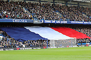 A French Tricoulor is held aloft by the Matthew Harding stand before the Barclays Premier League match at Stamford Bridge, London<br /> Picture by Paul Chesterton/Focus Images Ltd +44 7904 640267<br /> 21/11/2015