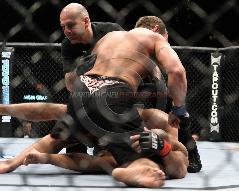 "LAS VEGAS, NEVADA, MAY 24, 2008: Referee Yves Lavigne (facing) invervenes to prevent Shane Carwin (top) from further damaging a defenceless Christian Wellisch during ""UFC 84: Ill Will"" inside the MGM Grand Garden Arena in Las Vegas"
