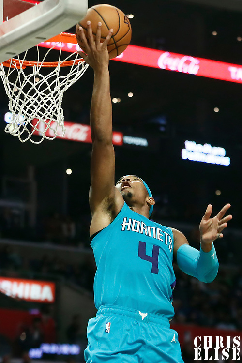 LOS ANGELES, CA - OCT 28: Devonte' Graham (4) of the Charlotte Hornets shoots the ball during a game on October 28, 2019 at the Staples Center, in Los Angeles, California.